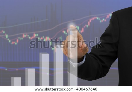Businessman analyzing bar graph for trade stock market. - stock photo