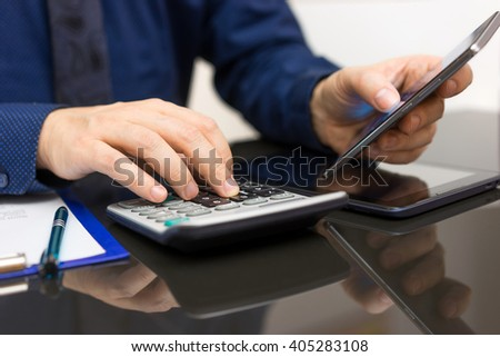 Businessman Analyzing  Business data on smart phone  and calculating, on line accounting concept - stock photo