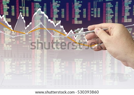 Businessman analyzing financial chart on virtual screen