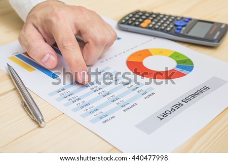 Businessman analyzing financial report on table. Accounting