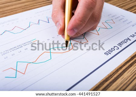 Businessman analyzing investment charts