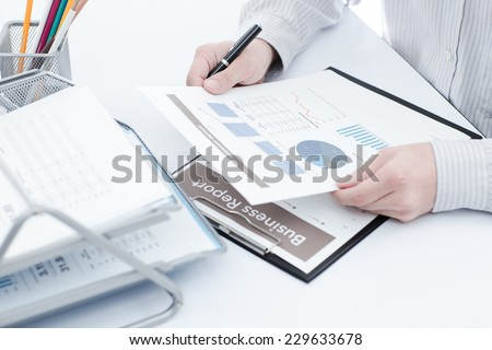 Businessman analyzing investment charts. Accounting