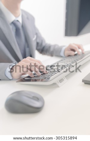 Businessman analyzing investment charts with computer. Accounting