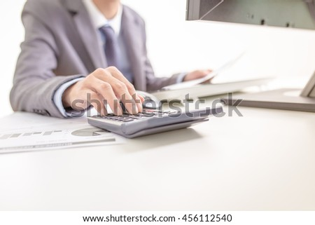 Businessman analyzing investment charts with computer. Accounting - stock photo