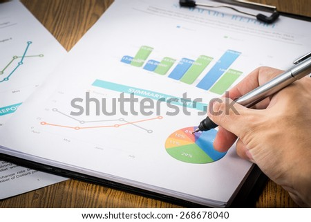 Businessman analyzing profit investment charts .vignetting style