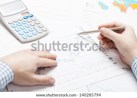 Businessman analyzing some financial data at the desk