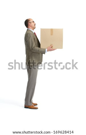 Businessman and a cardboard box on a white background - stock photo