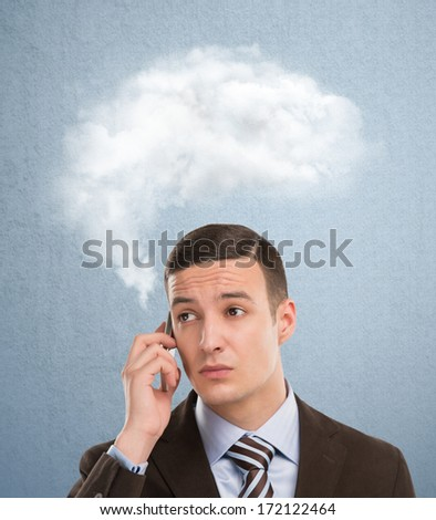 Businessman and a cloud of thoughts on a blue background - stock photo