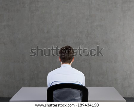 Businessman and a sketch of a lightbulb - stock photo