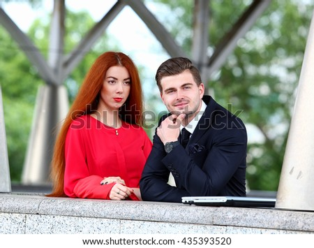 businessman and a young woman - stock photo