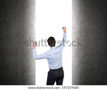 Businessman and an entrance to infinity - stock photo