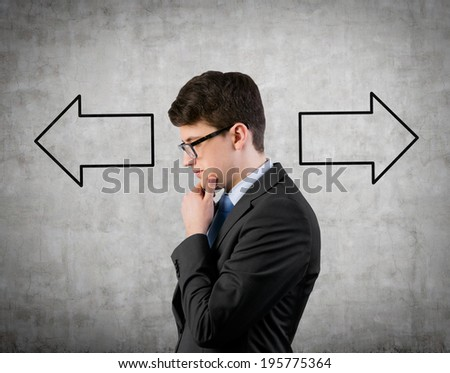 Businessman and arrows 'left or right'  - stock photo