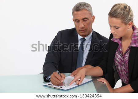 businessman and assistant examining a project