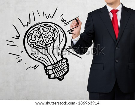 Businessman and brain bulb - stock photo