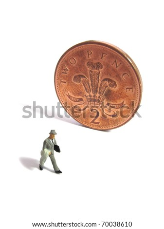 Businessman and British coin - stock photo