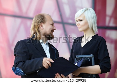 businessman and business woman are discussing