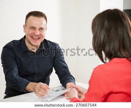 Businessman and businesswoman communicating with each other - stock photo
