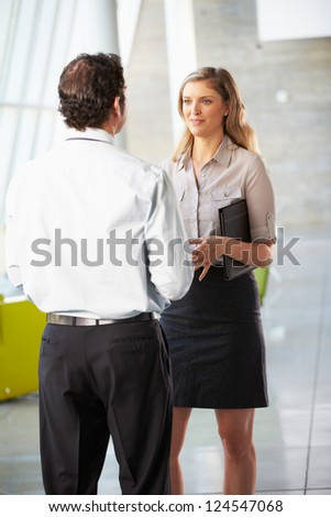 Businessman And Businesswoman Having Meeting In Office - stock photo