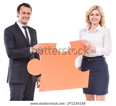 Businessman and businesswoman holding jigsaw puzzle. Business strategy concept. - stock photo