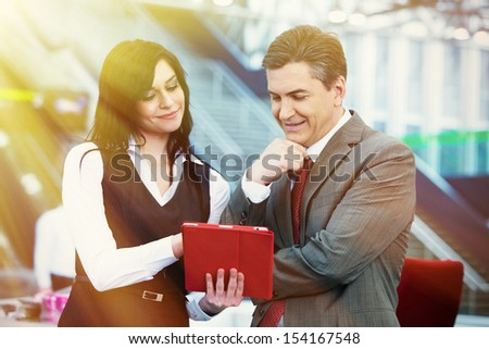 Businessman and businesswoman in modern office, - stock photo
