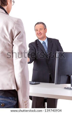 Businessman and Businesswoman in office - stock photo
