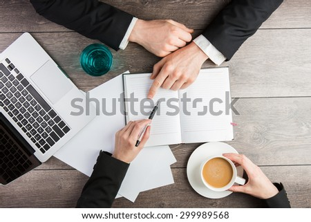 Businessman and Businesswoman joint coffee break. Top view. empty white space you can put your text - stock photo