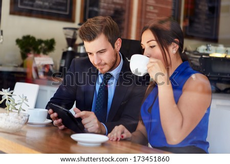 Businessman And Businesswoman Meeting In Coffee Shop - stock photo