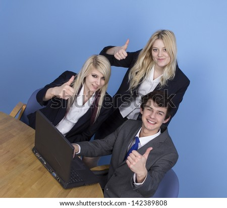 Businessman And Businesswoman Showing Thumb Up In Office