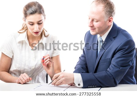 Businessman and businesswoman signing a papers