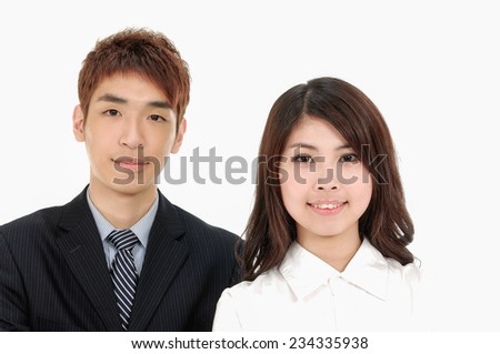 Businessman and businesswoman smiling - stock photo