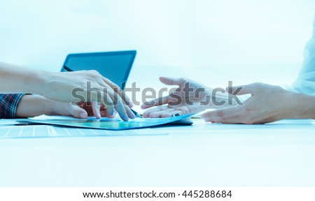 Businessman and businesswoman talk and write about something in meeting subject on paper document with film effect, copy space.