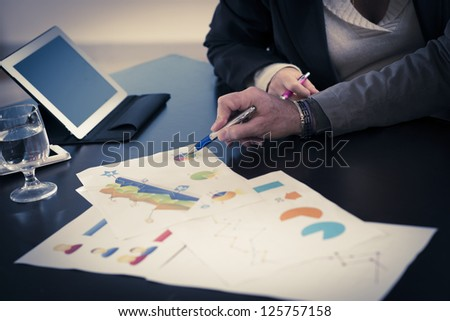 businessman and businesswoman talking about graphics - stock photo