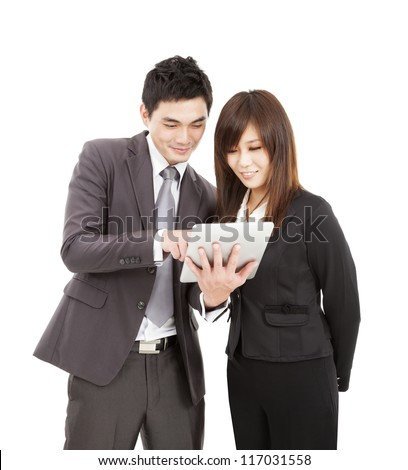 businessman and businesswoman using the tablet pc - stock photo