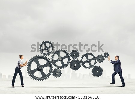 Businessman and businesswoman with cog wheel elements. Organization concept - stock photo