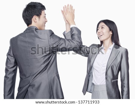 Businessman and businesswoman with hands against each other