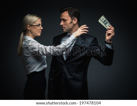 Businessman and businesswoman with money - stock photo