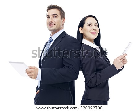 businessman and businesswoman with tablet computer standing back to back, isolated on white background. - stock photo