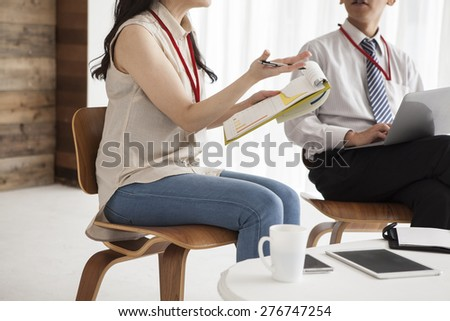 Businessman and businesswoman working together