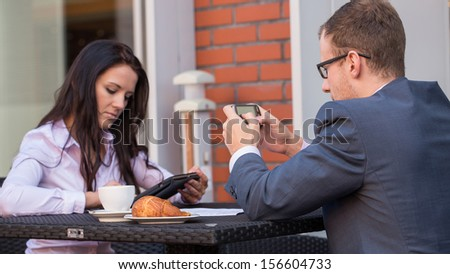 Businessman and businesswomen having a meeting in cafe.