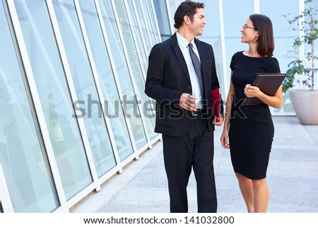 Businessman And Businesswomen Walking Outside Office - stock photo