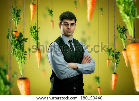 Businessman and carrots - stock photo