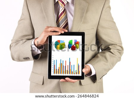 Businessman and CEO presenting and analyzing corporate financial data using a tablet computer - stock photo