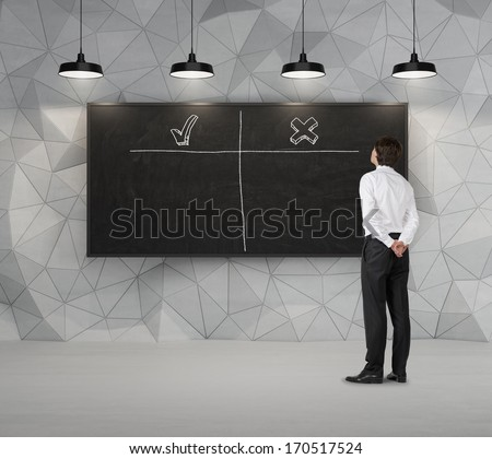 Businessman and chalkboard - stock photo
