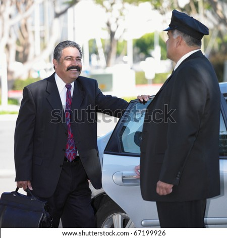 Businessman and chauffeur at car - stock photo