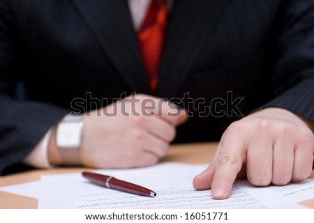 Businessman and contract papers