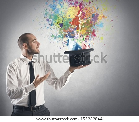 Businessman and creative idea concept with hat from which emerge the colors