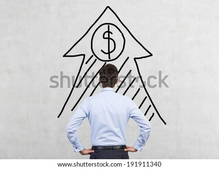 Businessman and dollar arrow - stock photo