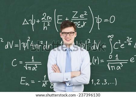 businessman and drawing mathematic formula on blackboard - stock photo