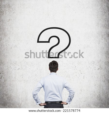 Businessman and drawn question mark. - stock photo