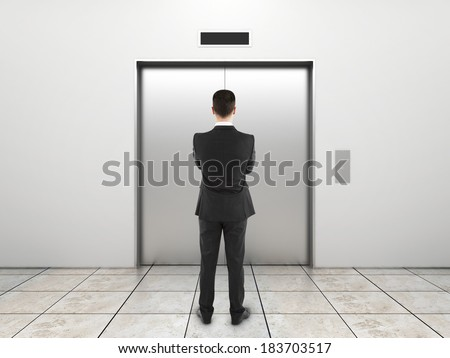 businessman and elevator with closed doors